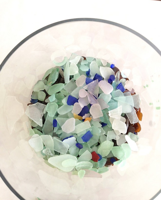 Sorting the beach glass into a vase by color.