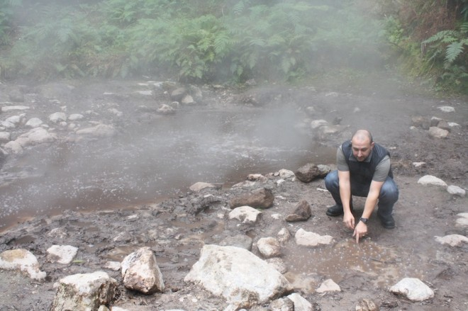 Yes, that's Pete kneeling next to a puddle of boiling spring water. Always boiling.