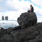 Watching the ocean on a big piece of lava rock.